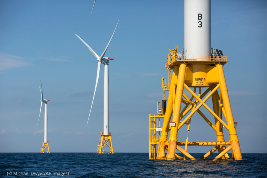 WInd turbines standing offshore (© Michael Dwyer/AP Images)