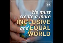 Hands holding globe with text saying we must create a more inclusive and equal world (State Dept.)