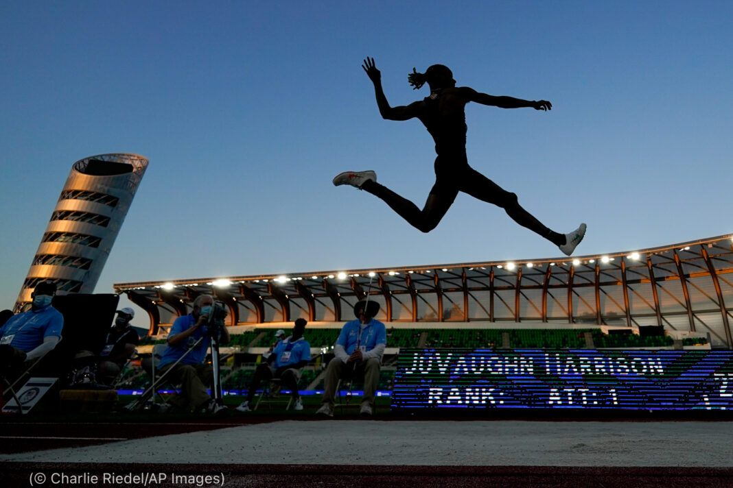Silhouette of man performing long jump (© Charlie Riedel/AP Images)